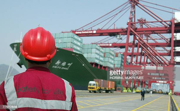 A worker watches operations at the container offloading terminal in the Jawaharlal Nehru Port Trust premises in Mumbai 04 january 2007 JNPTIndia's...