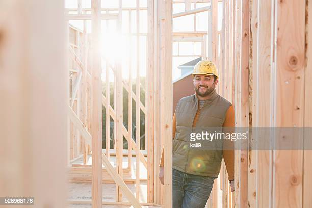 Worker wearing hardhat at construction site