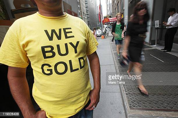 A worker wears a 'We Buy Gold' shirt in the Diamond District of Manhattan on July 18 2011 in New York City The price of gold rose above $1600 an...