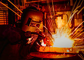 worker welding in  automotive factory