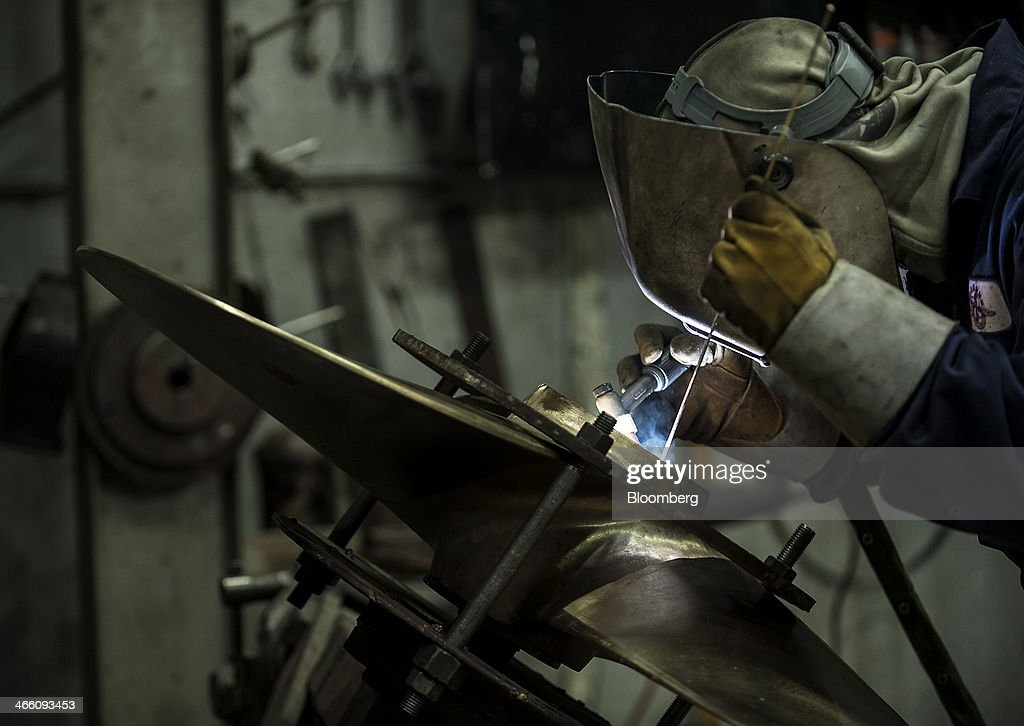 A worker welds a propeller core at the Osborne Propellers Ltd. facility in North Vancouver, British Columbia, Canada, on Wednesday, Jan. 29, 2014. Canada's gross domestic product expanded for a fifth straight month in November as the nations oil and gas production rebounded, adding to evidence the nations economy is picking up steam. Photographer: Abigail Saxton/Bloomberg via Getty Images