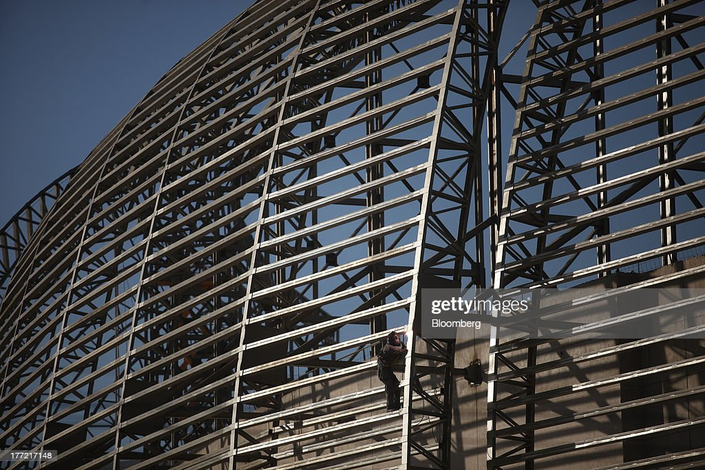 A worker welds a section of the Metropolitano Barra Shopping center under construction in Rio de Janeiro, Brazil, on Wednesday, Aug. 21, 2013. Latin America's largest economy created 7,154 manufacturing jobs and 4,899 construction jobs in July, down from 24,718 and 25,433 new posts a year ago. Photographer: Dado Galdieri/Bloomberg via Getty Images