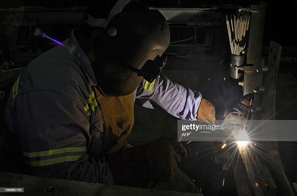 A worker welds in the structure of the bogie of one of the the historic wagons of La Brugeoise that remains parked at the garage El Polvorin, in the neighborhood of Caballito, Buenos Aires on January 4, 2013. The Line A will be closed betwen January 12 and March 8 following a decision by Buenos Aires city Mayor Mauricio Macri to replace the fleet with Chinese-made wagons. Line A was the first subway line to work in the southern hemisphere and its trains are among the ten oldest still working daily. The La Brugeoise wagons were constructed between 1912 and 1919 by La Brugeoise et Nicaise et Delcuve in Belgium.