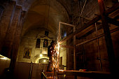 A worker welds scaffoldings at the Church of the Holy Sepulchre in Jerusalem's Old City on May 29 ahead of restoration of the Tomb of Jesus The tomb...