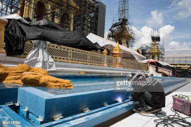 A worker welds while preparing the ceremonial ground for King Bhumibol Adulyadej's cremation at Sanam Luang park in Bangkok Thailand on Friday Sept 8...