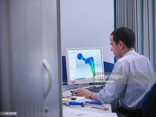 Worker with CAD drawing in office