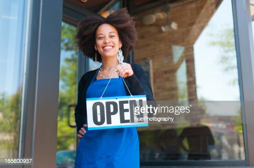 Worker with Open Sign