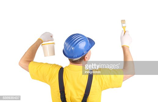 Worker with paint bucket and brush. : Stock Photo
