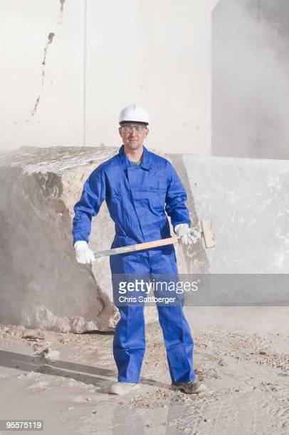 worker with sledgehammer