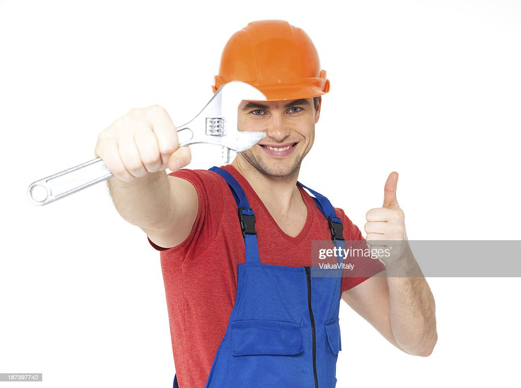 Worker with spanner showing thumbs up sign : Stock Photo