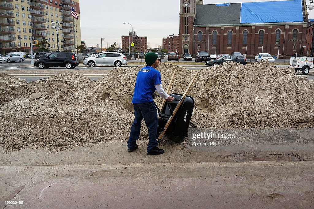 A worker with the Parks Department hauls sand from a playground damaged during Hurricane Sandy in the Rockaways on January 15, 2013 in the queens borough of New York City. A $50.7 billion Superstorm Sandy aid package is expected to be voted on today in the House. The package, which has come under criticism by some fiscal conservatives, is being heavily pushed by Northeastern lawmakers. The money would be spent on immediate needs to the region including $5.4 billion for New York and New Jersey transit systems and $5.4 billion for the Federal Emergency Management Agency's disaster relief aid fund.