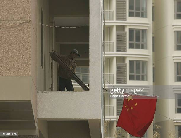 A worker works at a building under construction on April 5 2005 in Shanghai China The China Banking Regulatory Commission is carrying out...