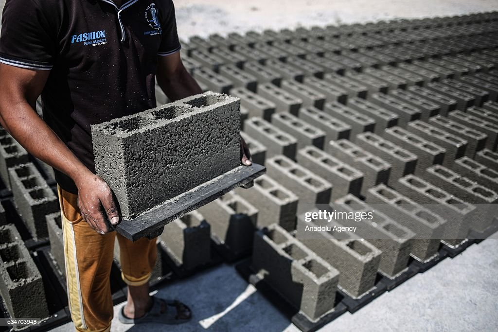 A worker works at a concrete brick factory, restarting to manufacture after Israel allowed building materials' passing from Karim Abu Salim border gate in Gaza City, Gaza on May 25, 2016.