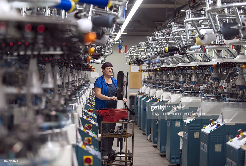 A worker works checks socks at the production unit of Bleuforet, a Made in France socks, tights, leggings with natural fibers company, in Vagney on December 4, 2012.