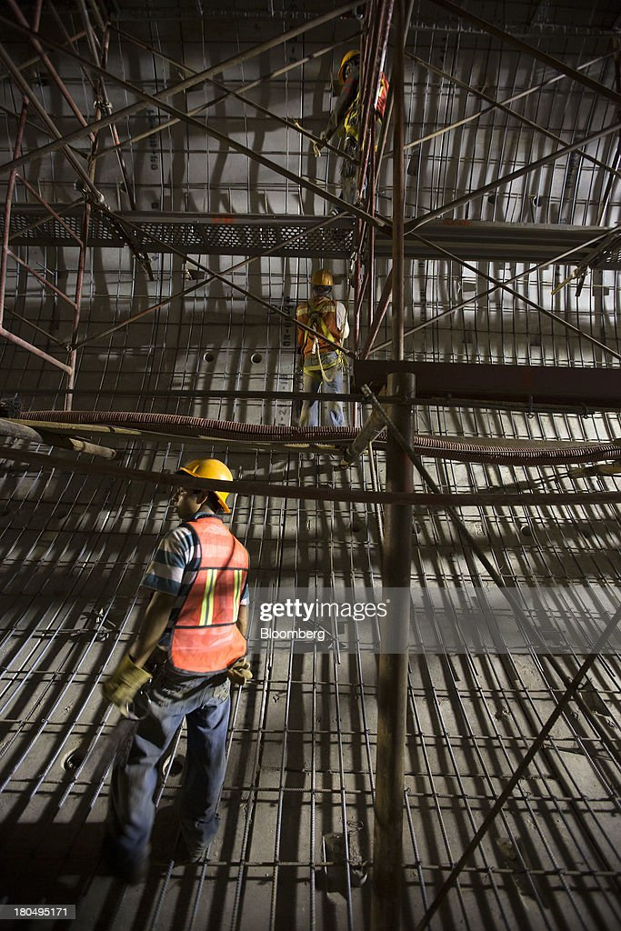 Workers add and align steel rods on scaffoldings inside the Tunnel Emisor Oriente (TEO), or Eastern Discharge Tunnel, during construction of the 38 mile (62km) underground wastewater treatment tunnel in Mexico City, Mexico, on Thursday, Sept. 12, 2013. The tunnel, which is expected to be completed in 2014, will boost Mexico City's drainage capacity to help prevent flooding during rainy season and the over-exploitation of groundwater resources. The project is being managed by Mexico's National Water Commission, Conagua. Photographer: Susana Gonzalez/Bloomberg via Getty Images