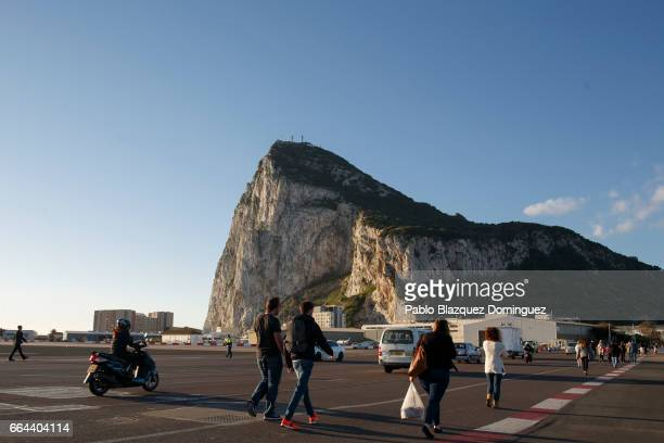 Workers amid other members of the public cross the airport lane from the Spainish border to Gibraltar on April 4 2017 in Gibraltar Gibraltar Tensions...