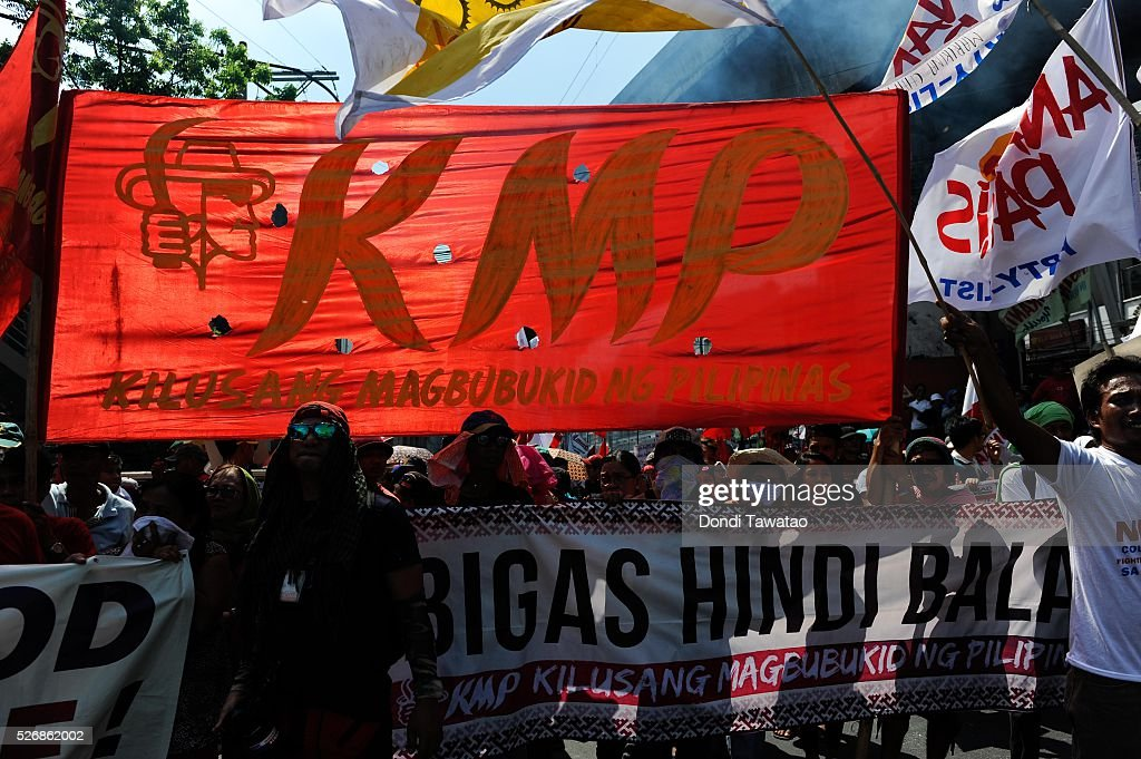 Workers and left-wing trade unions march during a labor day rally on May 1, 2016 in Manila, Philippines. Philippine presidential candidates have pledged to abolish the 'End of Contract' policy or contractual labor which is the process by which companies hire employees for less than six months to avoid being covered by the labor code requirement to regularize employment. At least 35 million workers out of 67.1 million are contractual workers according to government statistics.