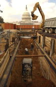 Workers and machinery dig a hole on the East Front of the Capitol in order to lay utility pipes for the Capitol Visitor Center