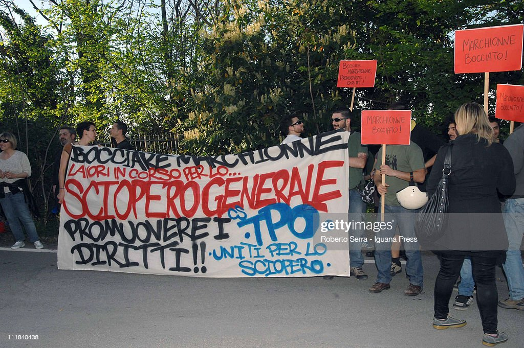 Workers and students protest outside the building where Fiat CEO Sergio Marchionne is holding a leadership masterclass at Villaguastavillani on April 7, 2011 in Bologna, Italy. Under plans laid out by the company's Chief Executive Sergio Marchionne, FIAT will move to increase its stake in Chrysler by 5% to 30% over the next few months with the intention of securing at least 35% by the end of 2011.