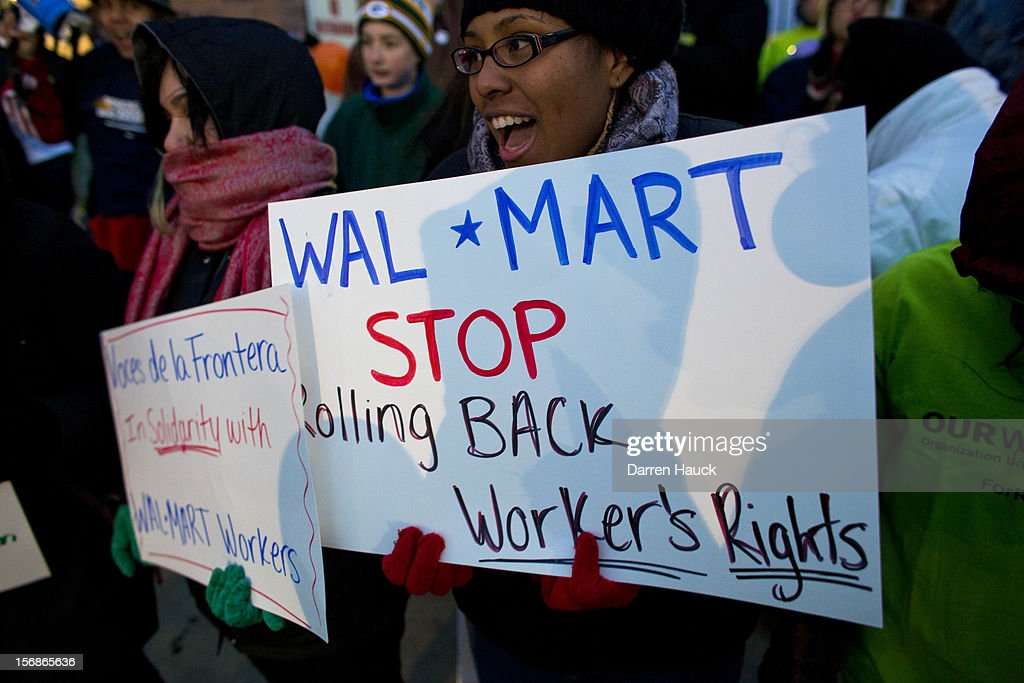 Workers and supporters march outside a local Wal-Mart retail store on Black Friday November 23, 2012 in Milwaukee, Wisconsin. The protestors were calling for better wages and working conditions for the employees.