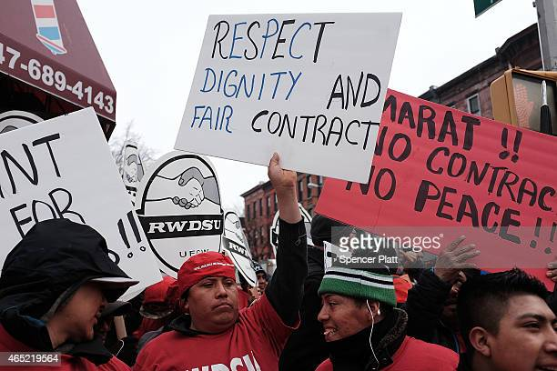 Workers and supporters march to the Vegas Auto Spa a car wash that has become a focal point for labor and union rights during a rally on March 4 2015...