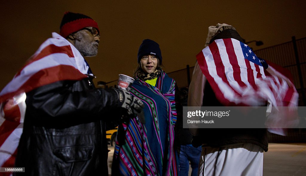 Workers and supporters prepare to march outside a local Wal-Mart retail store on Black Friday November 23, 2012 in Milwaukee, Wisconsin. The protestors were calling for better wages and working conditions for the employees.