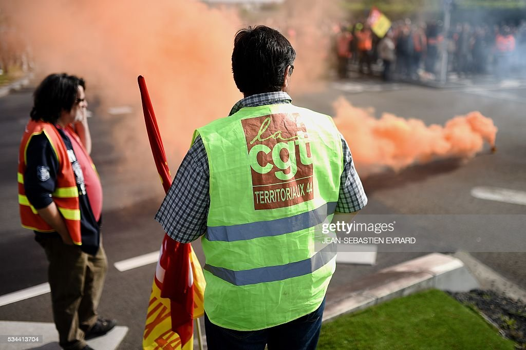 Workers and union members gather in Saint-Nazaire, western France, to demonstrate against the government's planned labour law reforms on May 26, 2016. France's Socialist government has bypassed parliament and rammed through a labour reform bill that has sparked two months of massive street protests. EVRARD