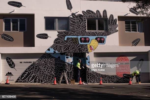 Workers apply a protective coat over the wall mural painted by Mulga in Marrickville on August 7 2017 in Sydney Australia Perfect Match is an Inner...