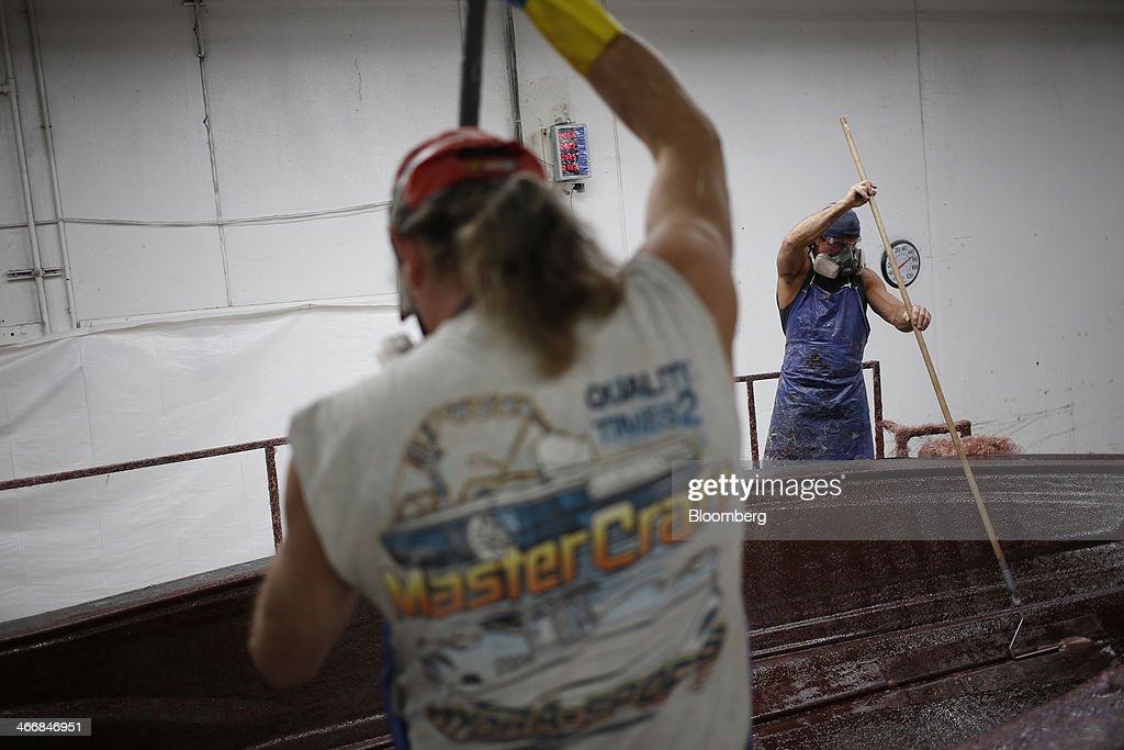 Workers apply fiberglass to an inboard speed boat mold at the Mastercraft Boat Co. factory in Vonore, Tennessee, U.S. on Tuesday, Feb. 4, 2014. Orders for U.S. factory goods, excluding transportation, rose .2 percent in December, according to data released by the Census Bureau. Photographer: Luke Sharrett/Bloomberg via Getty Images
