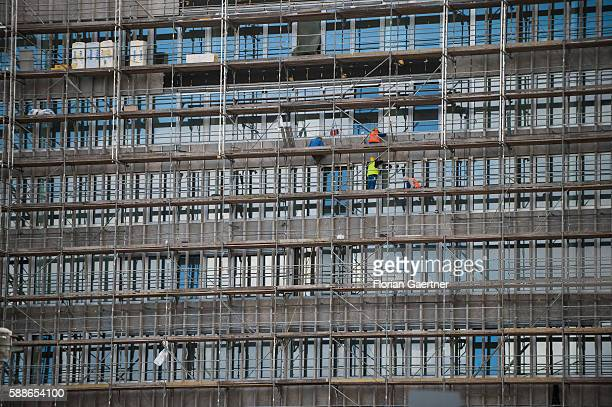 Workers are captured on a scaffolding on August 11 2016 in Berlin Germany