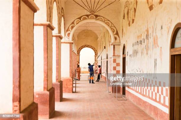 Bolivia San Jose de Chiquitos November 25 2016 Workers are cleaning the portico with its wall paintings of the Jesuit reduction in San Jose
