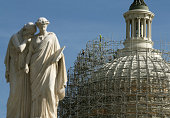 Workers are close to completely surrounding the US Capitol dome in scaffolding for restoration October 28 2014 in Washington DC The restoration of...