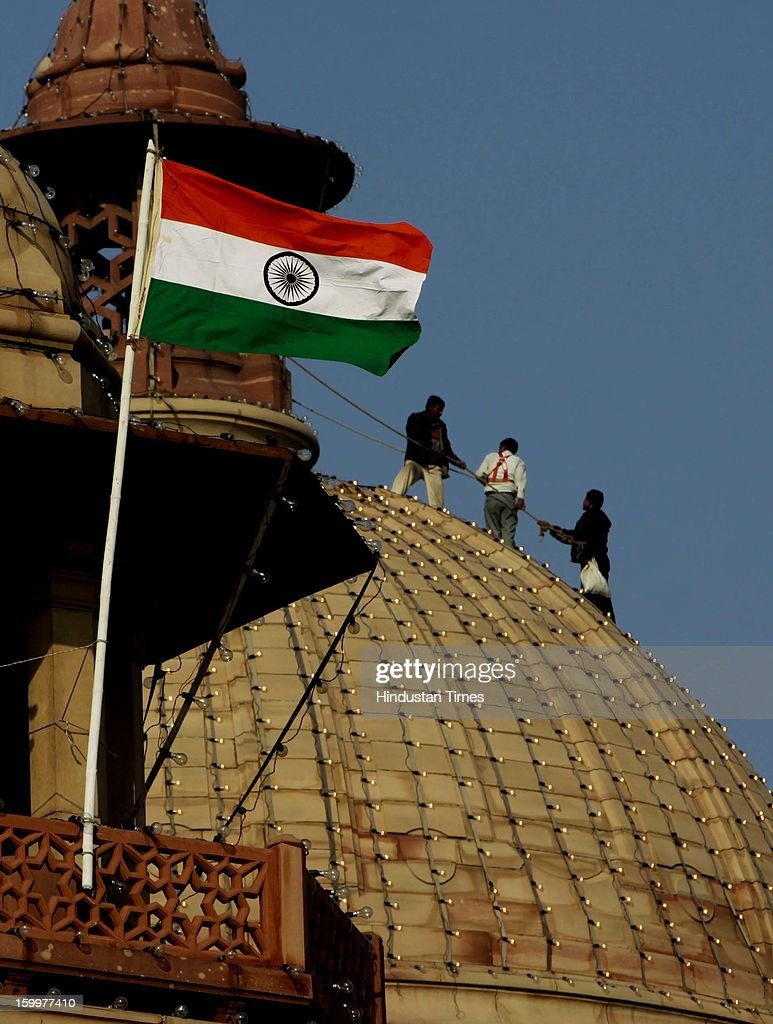 Workers are decorating dome of North Block with lights as National flag erected there as preparations of Republic Day are on, on January 24, 2013 in New Delhi, India.