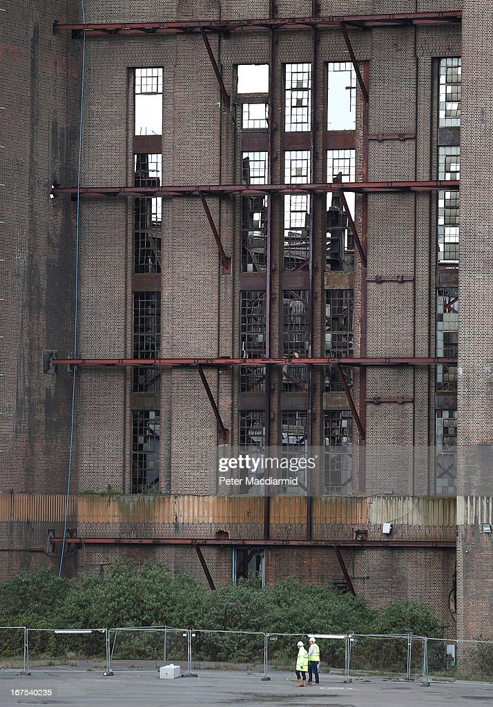 Workers are dwarfed by Battersea power station on April 26, 2013 in London, England. Built in the 1930s, with an identical second section added in the 1950s, the Grade II* listed building last generated electricity in 1983. The 15.7 hectare site on the south bank of The River Thames is being re-developed. Over the next 11 years 3400 homes, office space and a theatre will be built in and around the power station which is still the largest brick building in Europe.