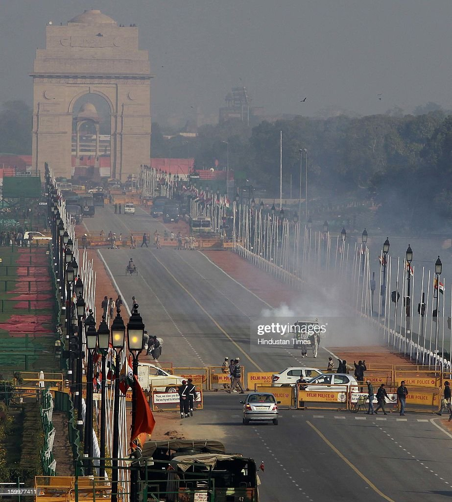 Workers are pesticide the Raj Path as preparations of Republic Day are on, on January 24, 2013 in New Delhi, India.