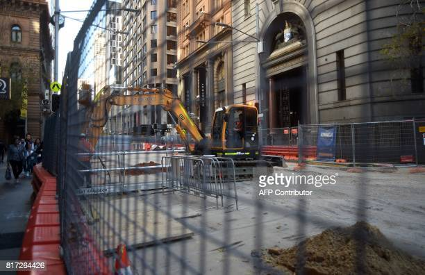 Workers are pictured at the construction site of the Sydney Light Rail project on July 18 2017 The project is expected to be completed and start...