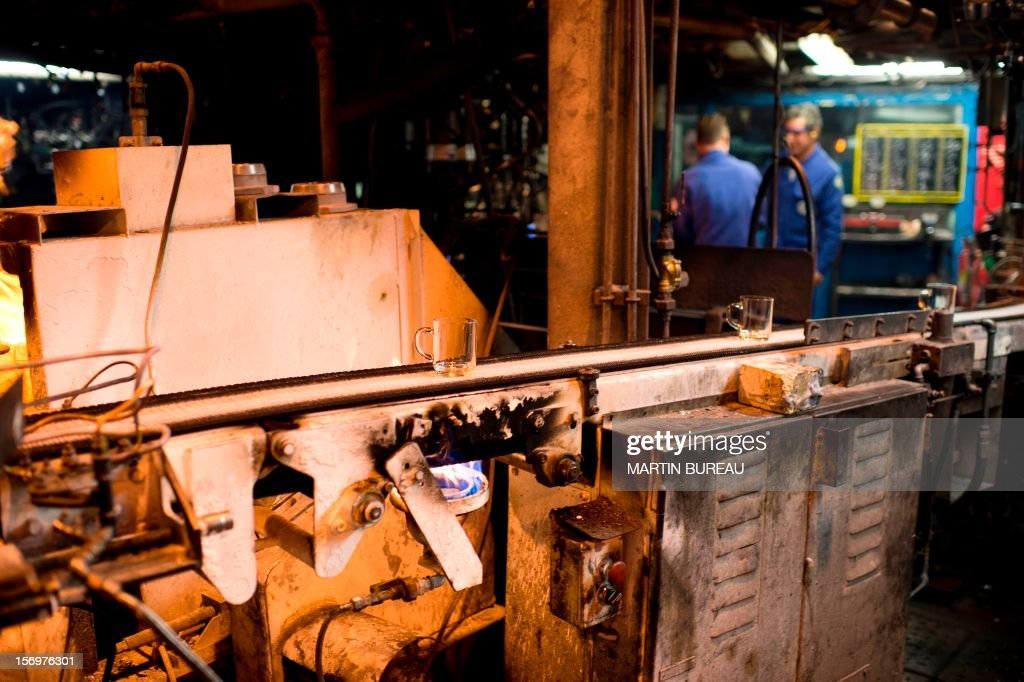 Workers are pictured at the factory of French manufacturer of glassware Duralex, on November 26, 2012 in La Chapelle-Saint-Mesmin.