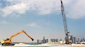 Workers are seen at a construction site in Doha on November 16 2014 Qatar host of the 2022 football World Cup pledged to introduce new legislation to...