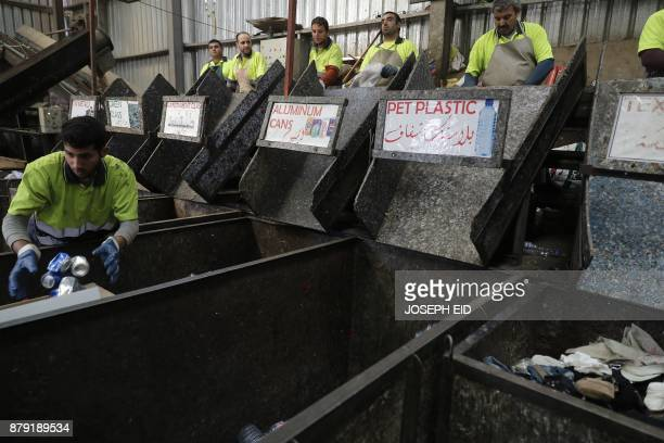Workers are seen at a waste treatment plant in the area of Monteverde east of Beirut on October 27 2017 The Lebanese divers plunge below the surface...