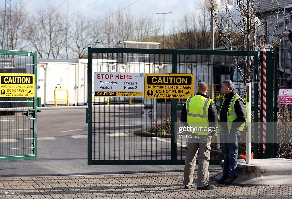 Workers are seen at the rear gates of the Greencore factory building on February 15, 2013 in Bristol, England. The convenience food manufacturer Greencore has been named in the ongoing horse meat scandal after traces of equine DNA were found in beef bolognese sauce that it sold to Asda.