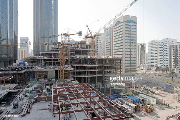 Workers are seen at the site of the Emporium construction an Aldar PJSC project in Abu Dhabi United Arab Emirates on Wednesday Jan 11 2012 Abu Dhabi...