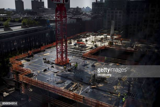 Workers are seen during construction at the 420 Kent Avenue apartment development in the Williamsburg neighborhood of the Brooklyn borough of New...