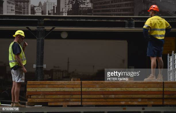 Workers are seen on a building site in the central business district of Sydney on April 19 2017 Australia's controversial decision to scrap a visa...