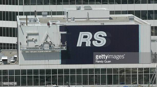 TORONTO ONTARIO Workers are shown halfway taking down the Eaton's sign and replacing it with it's parent company Sears today in downtown Toronto rq