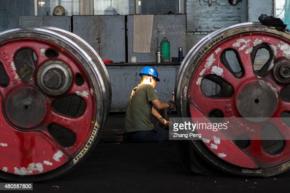 Workers are working in a maintenance factory for steam locomotives Fuxin located in China's northeast Liaoning Province which had the biggest open...