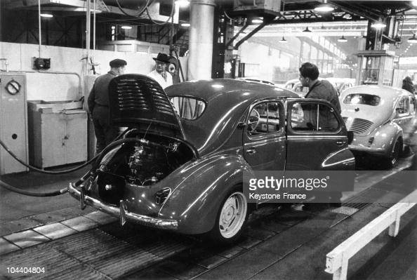 Workers are working on a 4CV in the RENAULT factory of BoulogneBillancourt in the 1950s