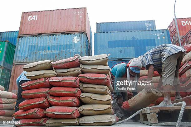 Workers arrange sacks of cement which will be transported to Sumatra Island at Sunda Kelapa port