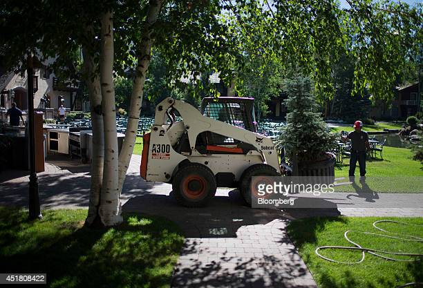 Workers arrange trees to form a barrier around the site of the Allen Co Media and Technology Conference in Sun Valley Idaho US on Monday July 7 2014...