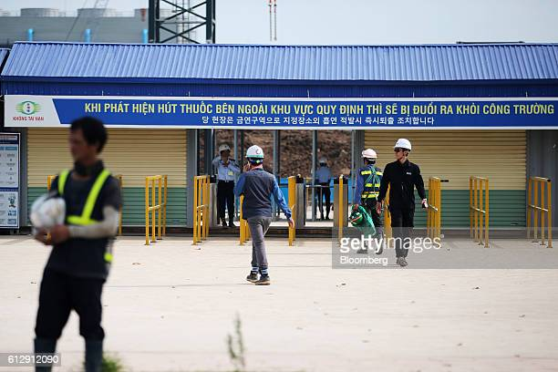 Workers arrive and depart the Samsung Electronics Vietnam Co Plant at Yen Phong Industrial Park in Bac Ninh Province Vietnam on Thursday Sept 1 2016...