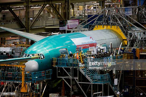 Workers assemble a Boeing Co 777 airplane at the company's production facility in Everett Washington US on Wednesday May 29 2013 Boeing Co won the...